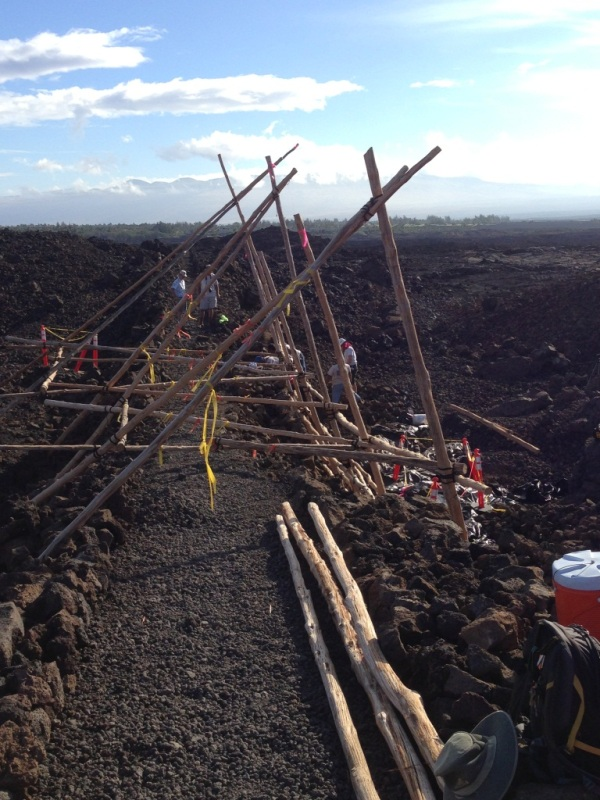 Olokea (traditional Hawaiian ladder system) spans section of trail stabilization project