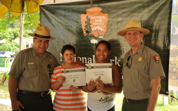 Newly inducted Junior Rangers with Park Ranger Sam and Chief Michael.
