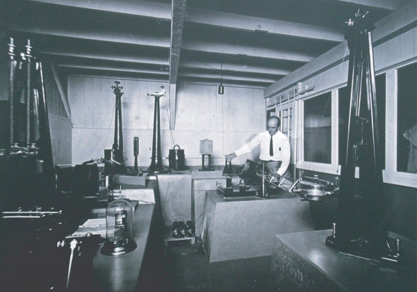 Hawaiian Volcano Observatory founder Thomas A. Jaggar with early seismic instruments housed in the Whitney Laboratory of  Seismology circa 1913. . USGS Photo.