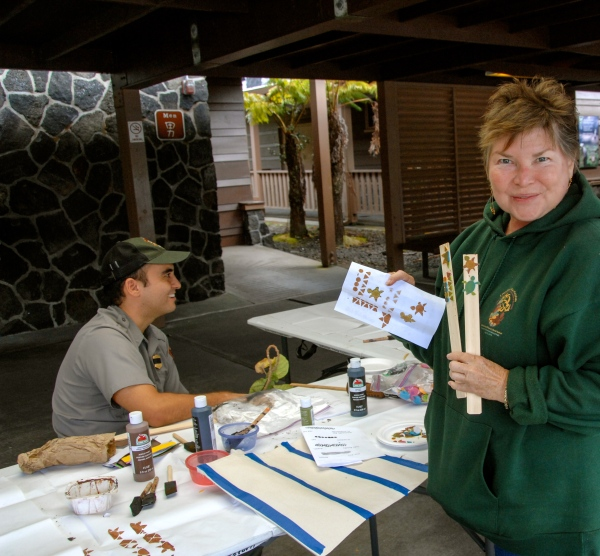 Workshop participant shows off her turtle 'ohe kāpala design. (NPS photo/ Stephen Geiger).