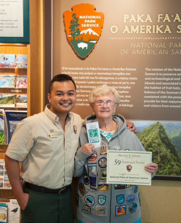 "Ranger Eymard with Sherrye Emery (aka ""the PATCH"" lady) with her National Park of American Samoa patch and her 59th Certificate."