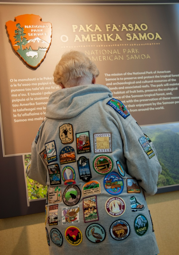 "Sherrye Emery (aka ""the PATCH lady"") wearing her national park patches."