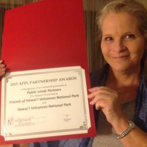 FHVNP Executive Director Elizabeth Fien displays the APPL Award shared with Hawai'i Volcanoes National Park for Public Lands Partnership.