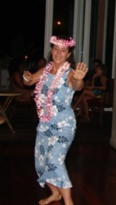 Judy Kinser dances hula.