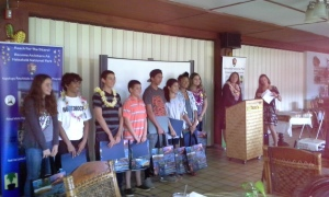 Graduation photo, left to right: Lilia, David, Arnubi, Aidan, Ho'i, Justine, Mahina, Katelynne, Intern Program Coordinator Serena Kaldi and Middle School Program Assistant Lily.
