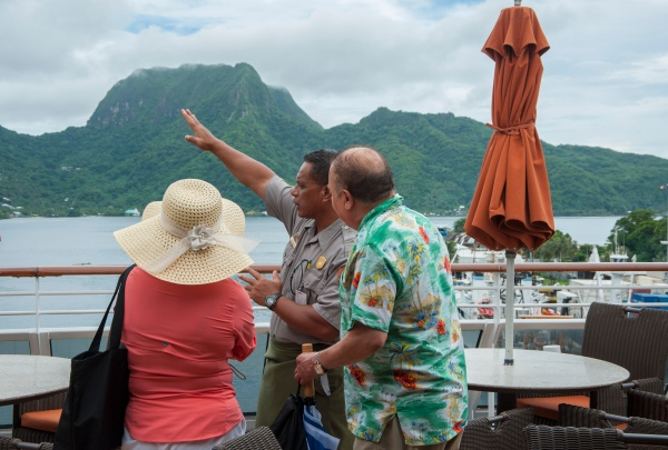 Ranger Pua on-board a cruise ship chats with passenger before his ranger talk.
