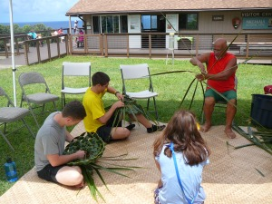 Bolly Helekahi teaching coconut weaving.